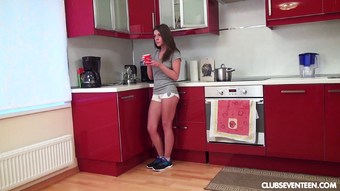 Perky boobs teen sits on the kitchen counter and toys her cunt