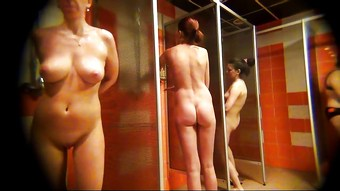 Spying on a girl with shaved pussy in the shower