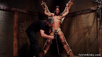 Ebony ass plugged in pile driver bondage