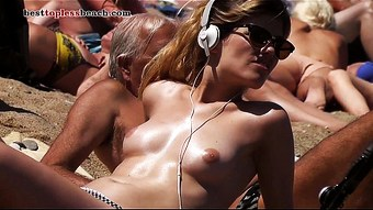 Wonderful blonde Topless on the Beach